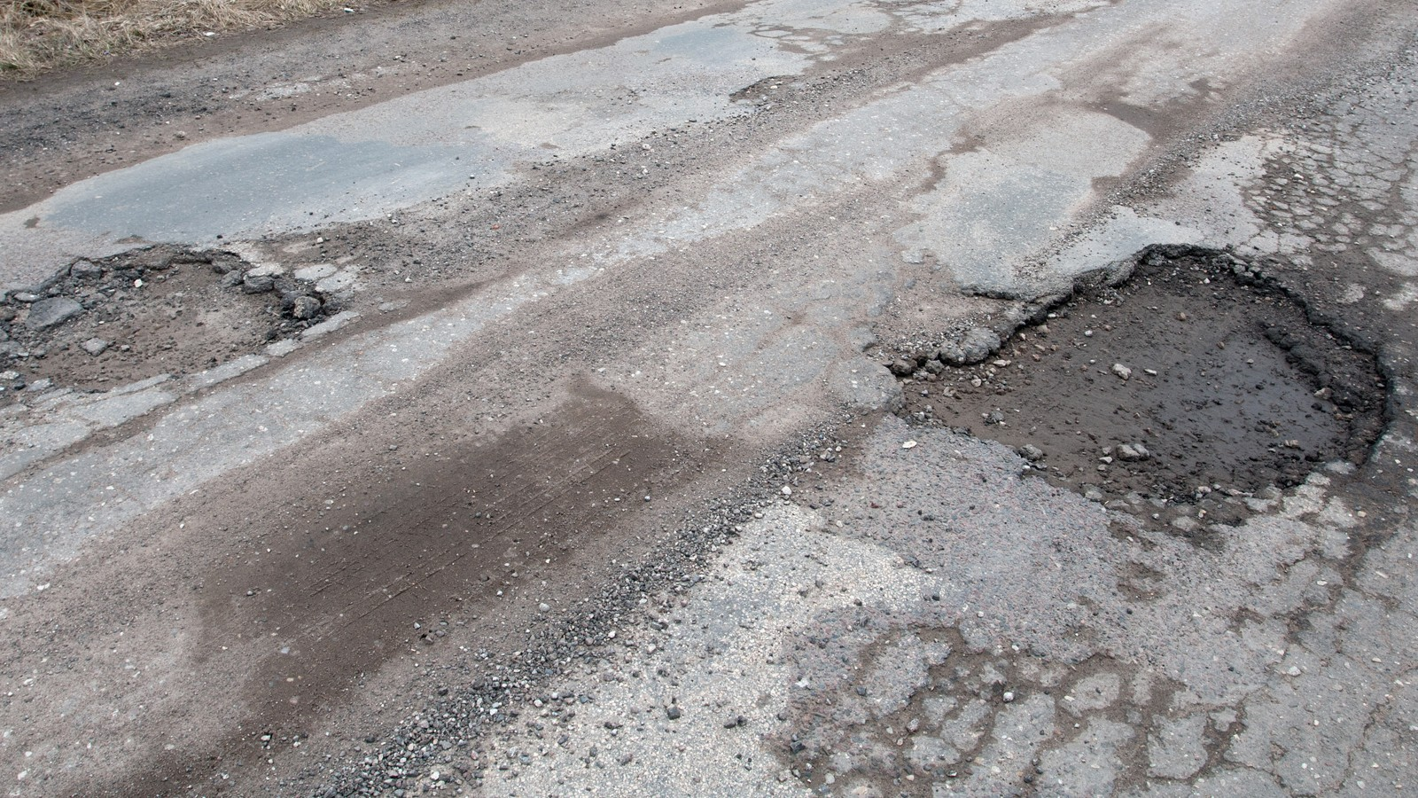 Damaged asphalt road after winter.