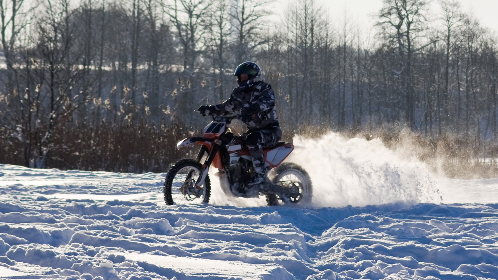 race on a motorcycle in the winter
