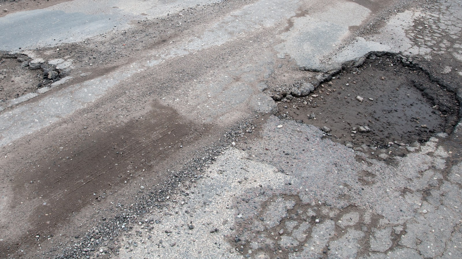 Damaged asphalt road after winter.