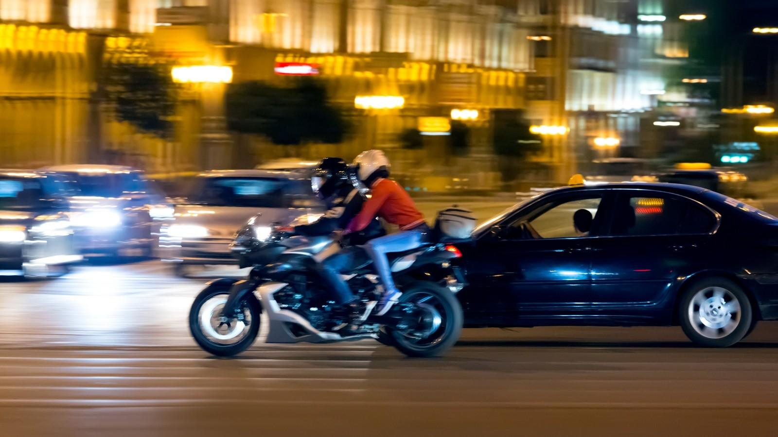 Motorcyclist on street at night