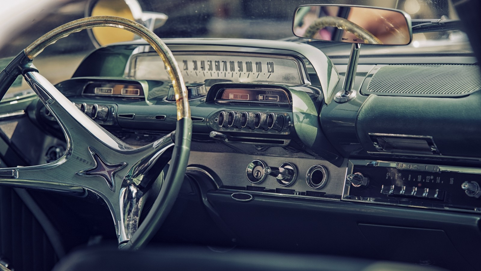 Sleza, Poland, August 15, 2015: Close up on old vintage car steering wheel and cockpit on Motorclassic show on August 15, 2015 in the Poland