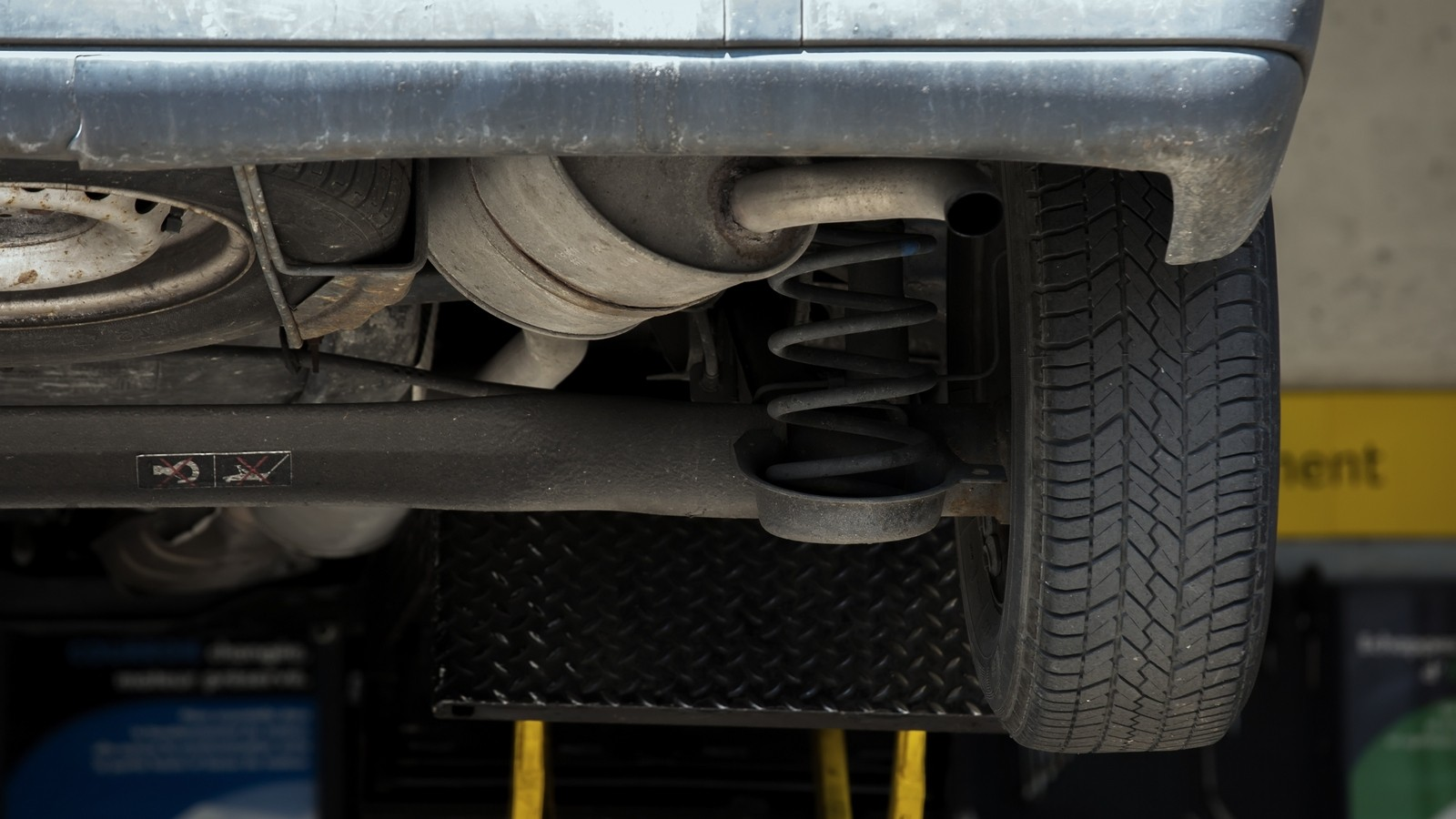 Close Up of shock absorbers replacement in a garage