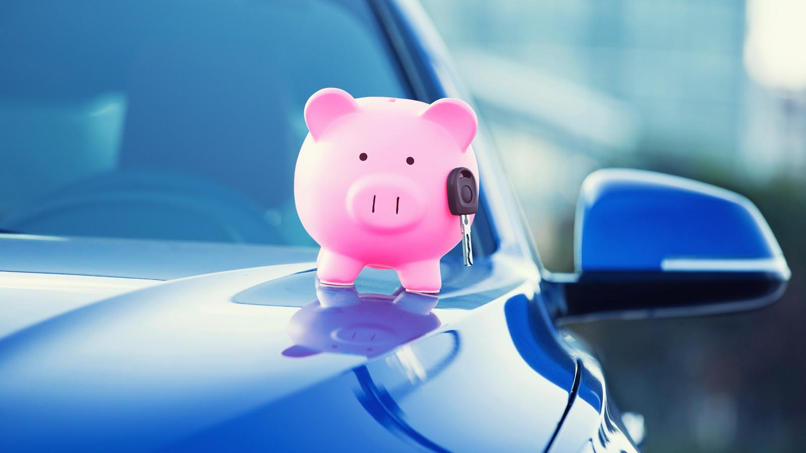 new car with piggy bank, key on hood