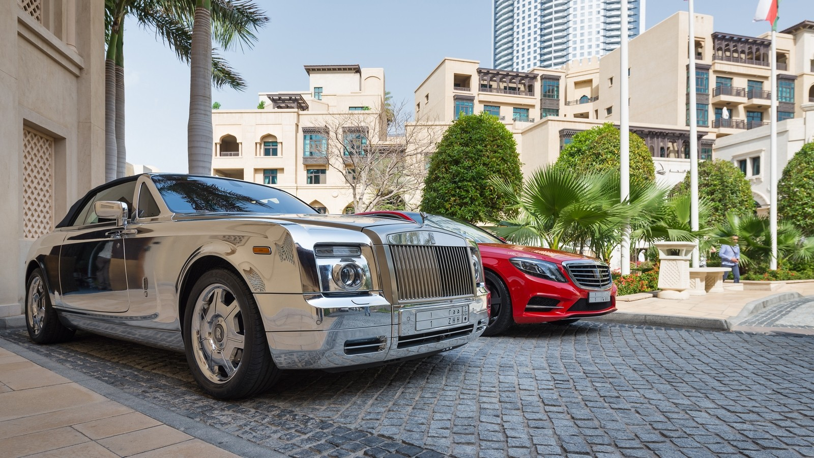 DUBAI, UAE — MARCH 30, 2014: Luxury car parked outside Palace Ho