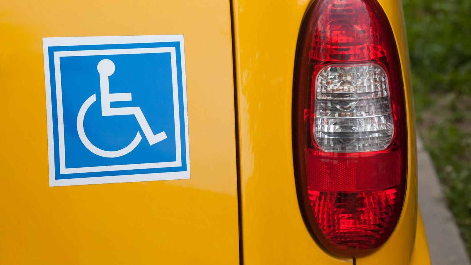 Handicapped sign on back of car