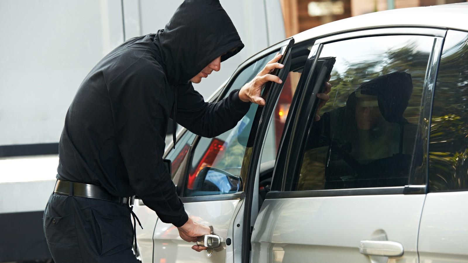 thief burglar at automobile car stealing