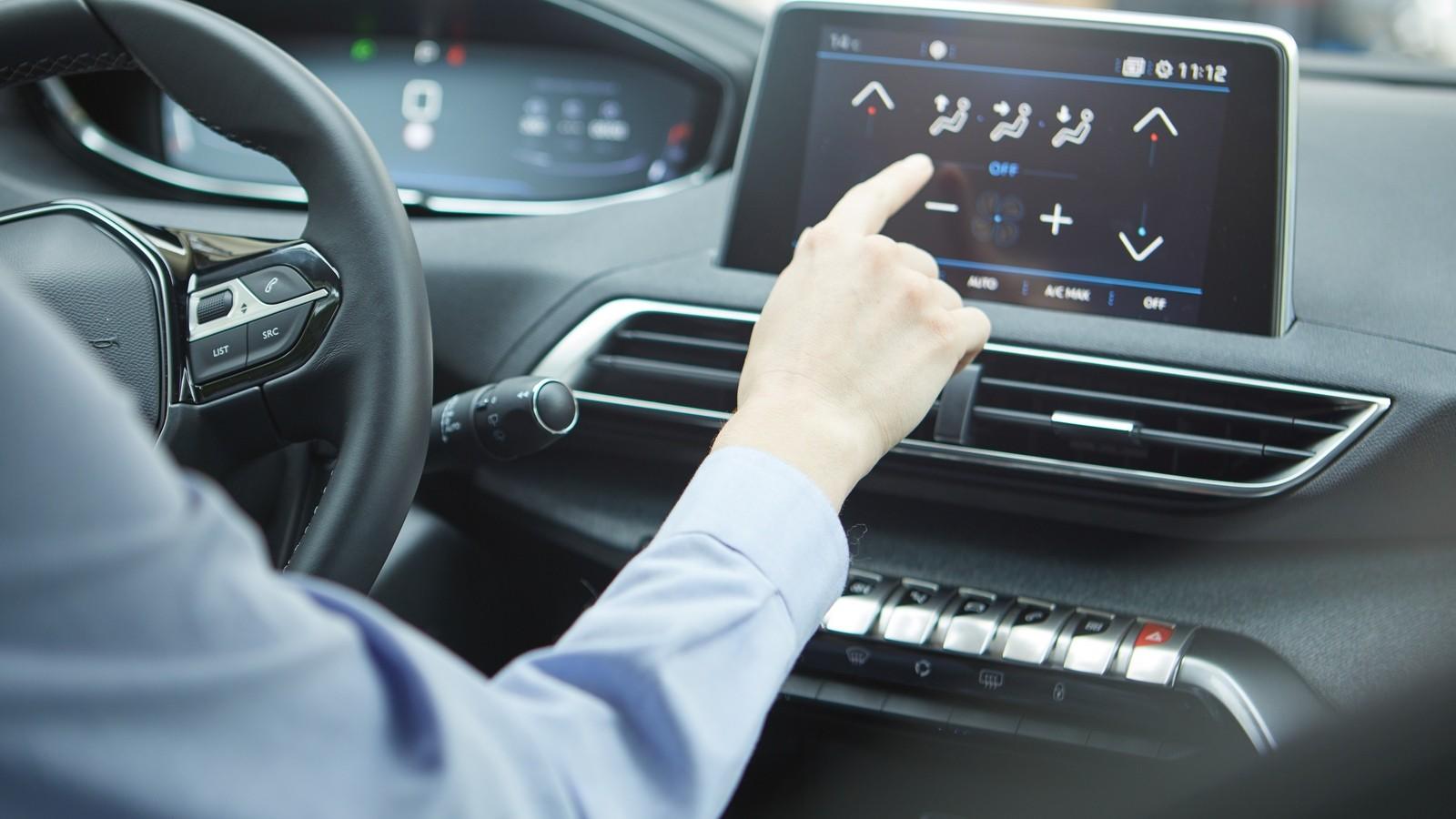 Car dashboard. Radio closeup. Woman sets up air conditioning