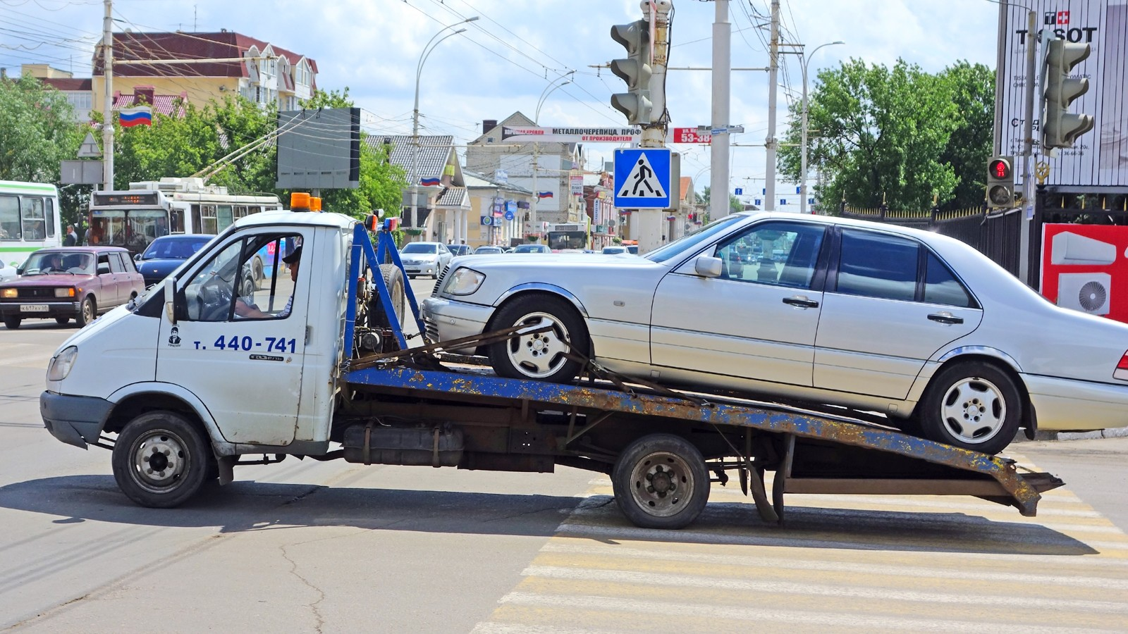 Tow truck with a car