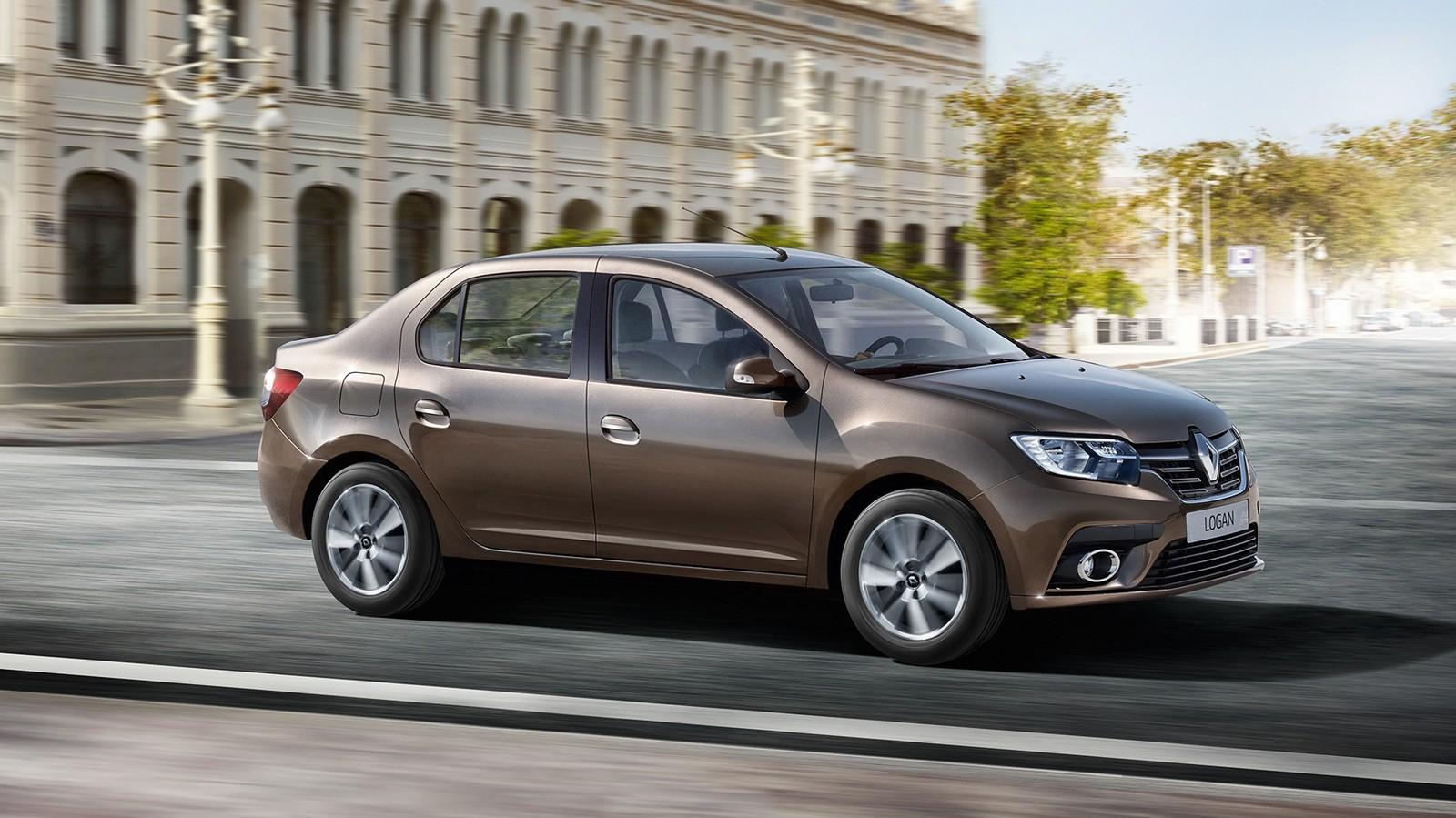 Renault Logan коричневый на ходу в городе