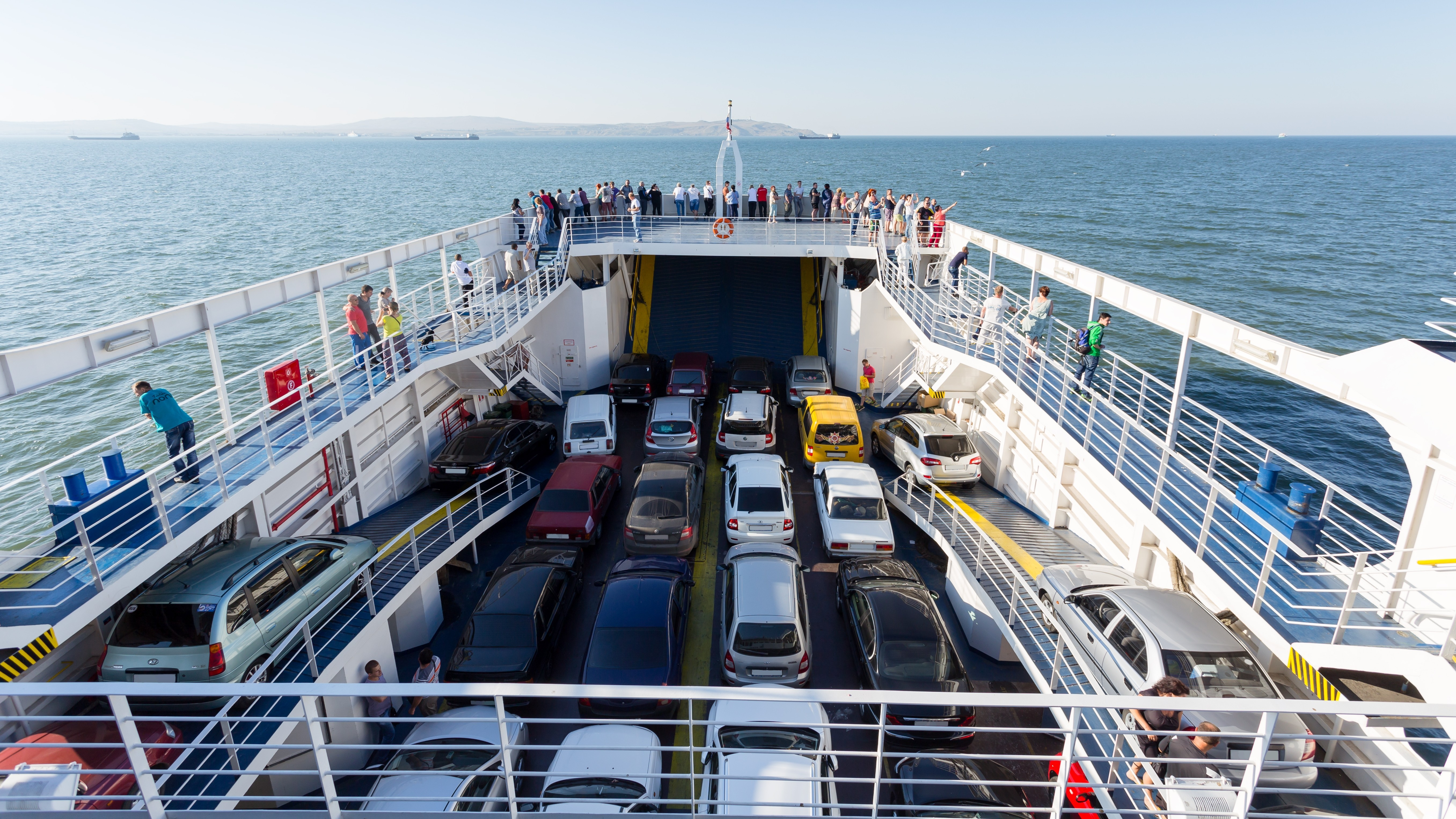 crimea, kerch ferry swimming with cars and tourists