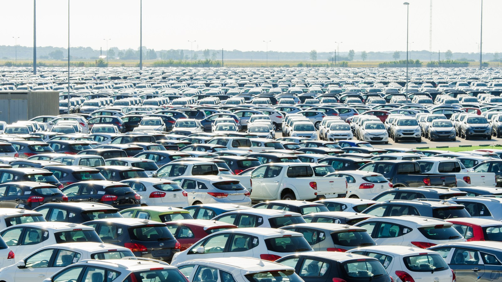 TUSCANY, ITALY — 27 June: New cars parked at distribution center