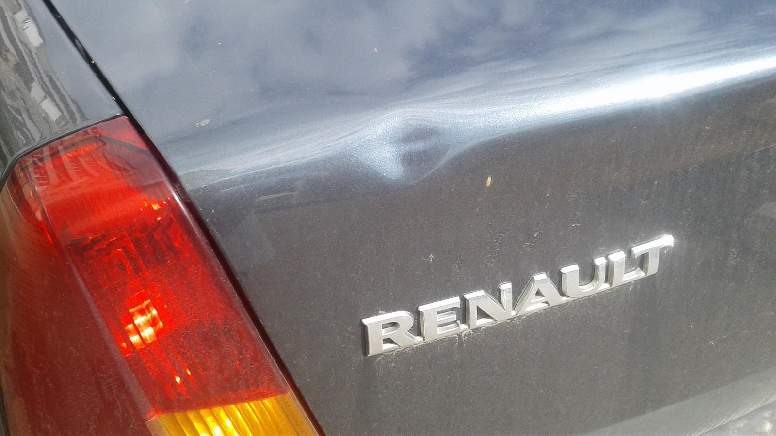 Renault Logan смятина на багажнике