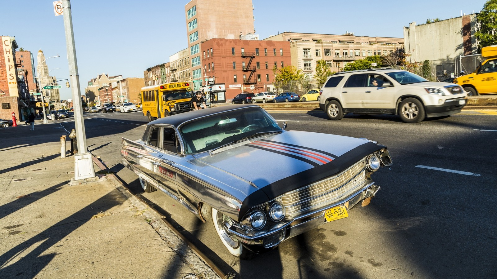 old chrome cadillac car parks on the street in New York