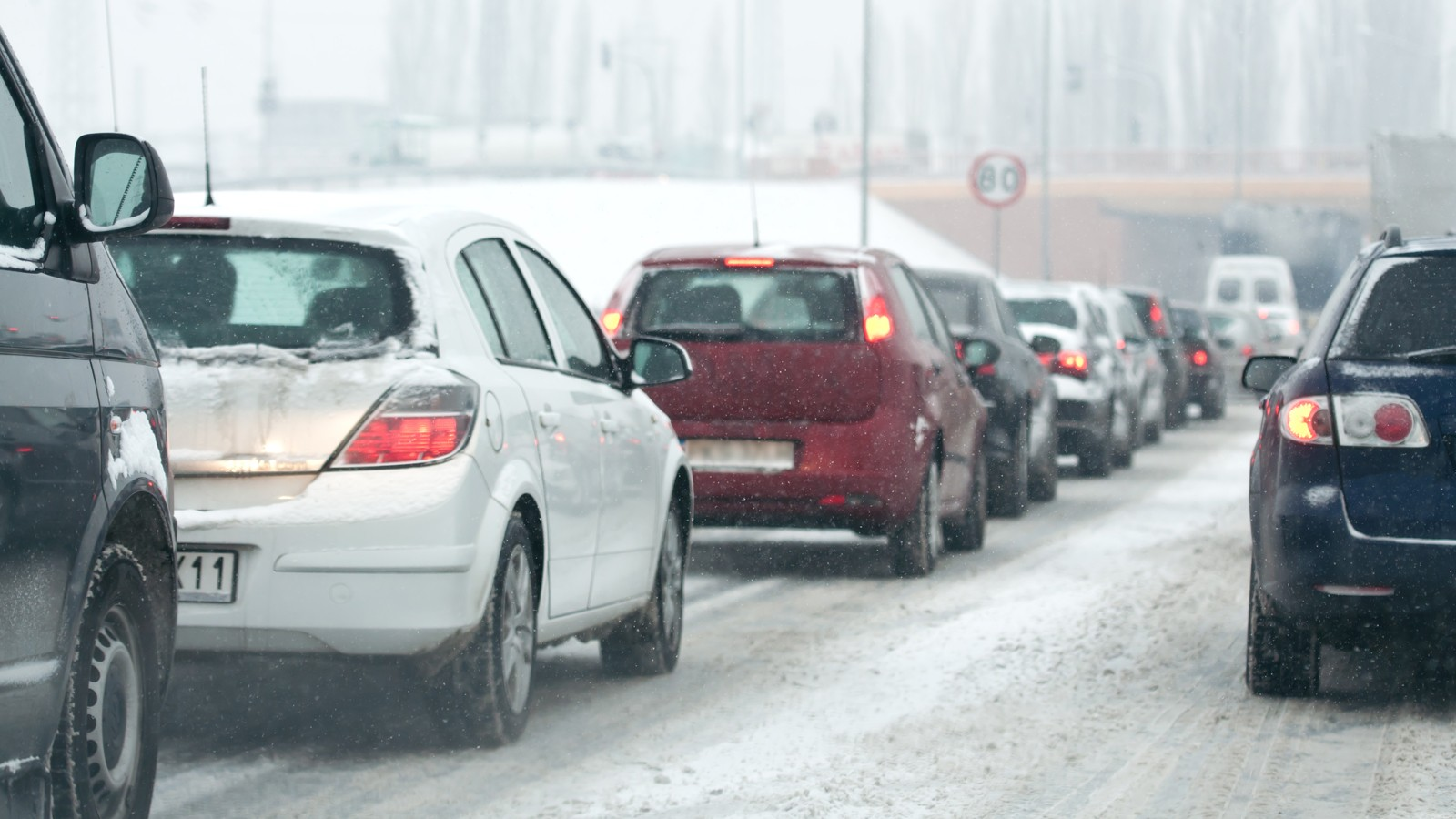 traffic jam in the city at winter time