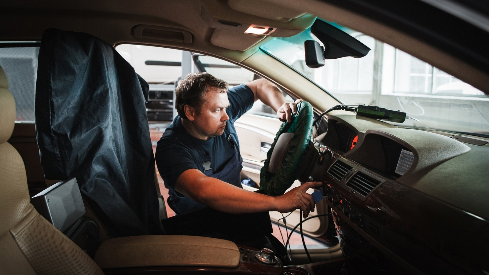 On-board computer tuning by serviceman at garage